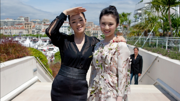 "Gong Li and Zhang Huiwen at a premiere for ""Coming Home"""