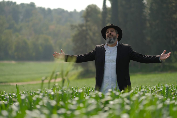 A rabbi who's out standing in his field.